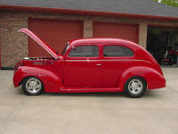 38 Ford sedan with a Full house Flathead, Lincoln Zephyr gears and a Halibrand quick change.