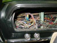 Picture of brand new wiring harness installed by another local shop.  The car came in with electrical issues,  GO FIGURE!!!  Check out all those butt splices.  This is what I call no man's land.  if you so much as touch one thing, 3 other gremlins appear.